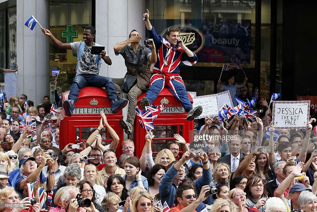 Spectators watch a parade during the London 2012 Victory Parade for Team GB and Paralympic GB athletes on September 10, 2012 in London, England.