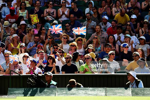 Spectators watch Andy Murray of Great Britain play in his Gentlemens Singles first round match against Mikhail Kukushkin of Kazakhstan on Murray...