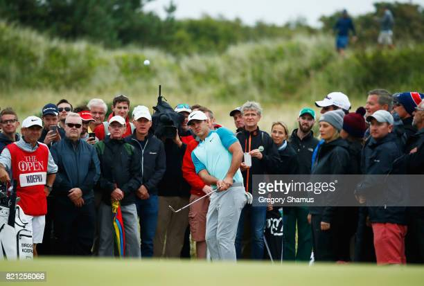 Spectators watch as Brooks Koepka of the United States chips onto the green during the final round of the 146th Open Championship at Royal Birkdale...
