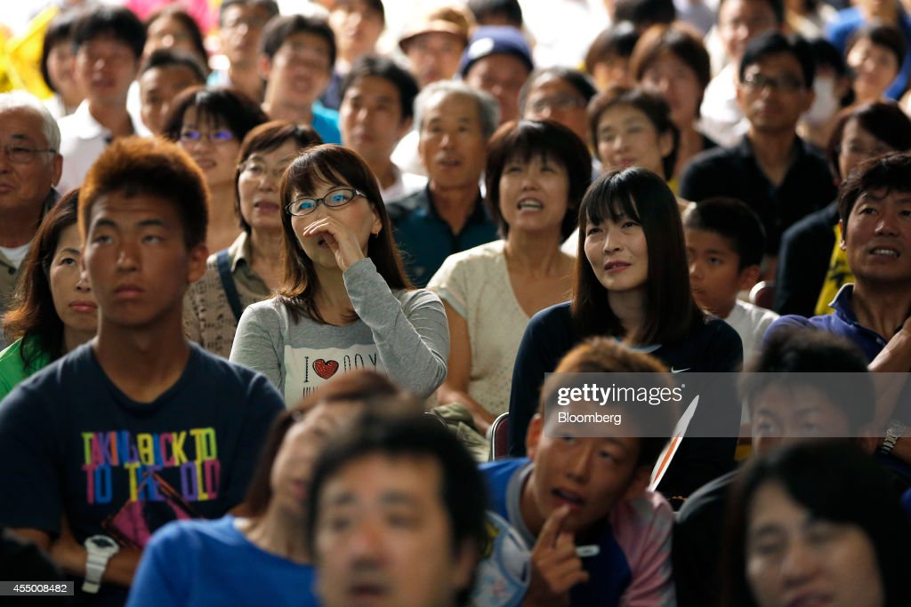 spectators in watch tennis player kei nishikori compete in spectators watch as s kei nishikori plays against s marin cilic in the u s open tennis
