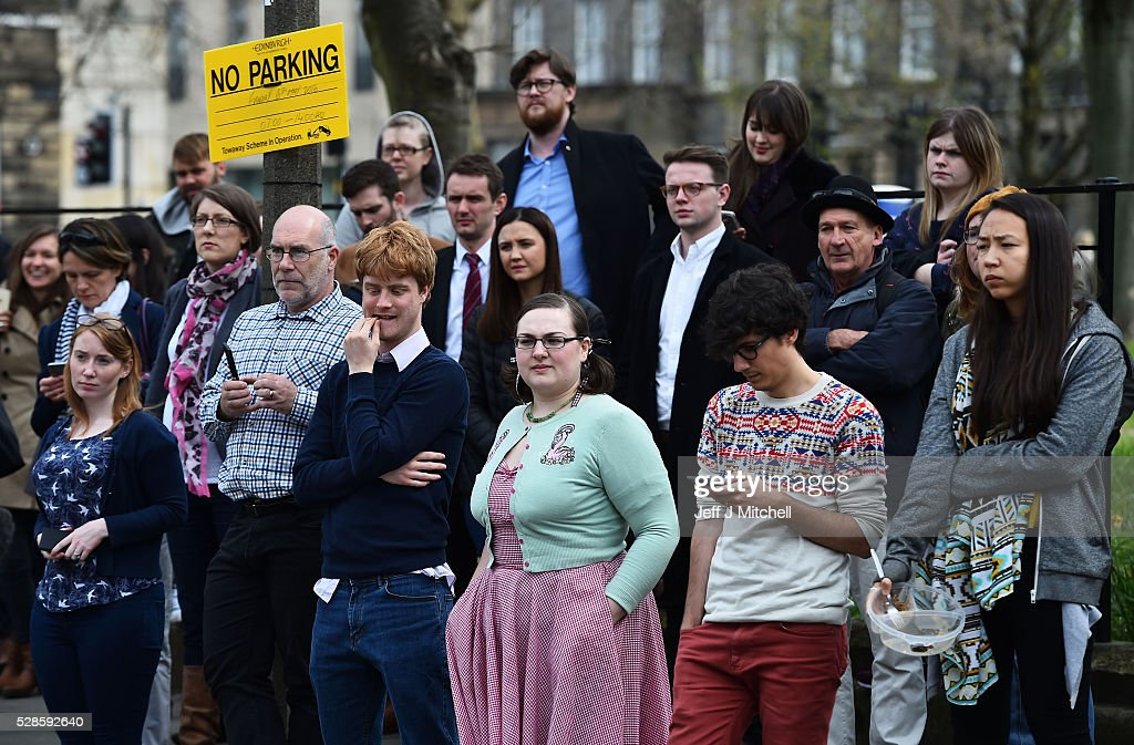 Spectators watch as Nicola Sturgeon announces she won't form a coalition but that her government will be inclusive at Holyrood on May 06, 2016 in Edinburgh, Scotland. Nicola Sturgeon, leading the Scottish National Party, won a historic third term at the Holyrood elections overnight. The SNP will likely form a minority government after failing to win a majority taking 63 seats out of a possible 129. The Conservative Party became the second largest party pushing Labour into third place.