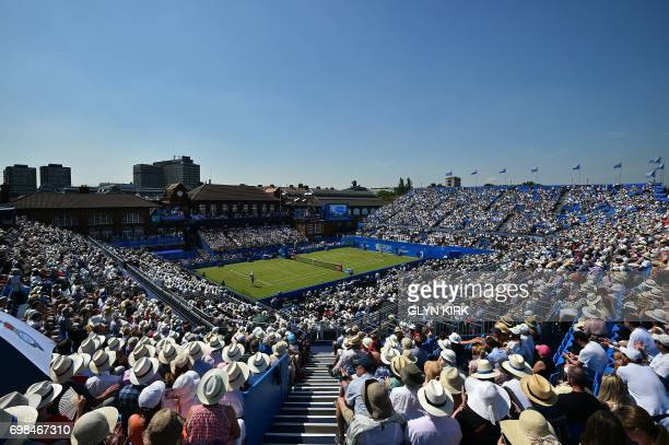 TOPSHOT Spectators watch as Switzerland's Stan Wawrinka plays against Spain's Feliciano Lopez in their men's singles first round tennis match at the...