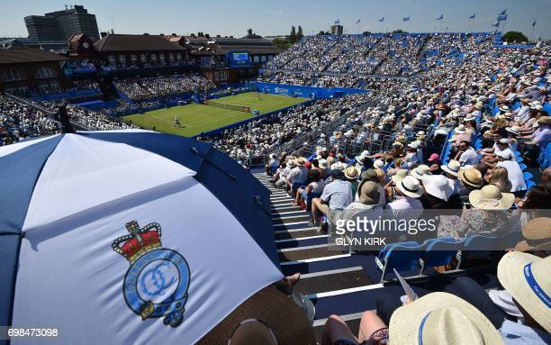 Spectators watch as Switzerland's Stan Wawrinka plays against Spain's Feliciano Lopez in their men's singles first round tennis match at the ATP...