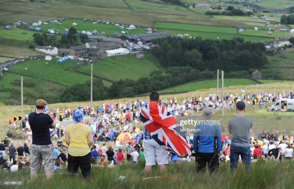 Spectators watch as the peloton approaches the long climb at Holm Moss in Yorkshire on Stage 2 of the Tour de France on July 6, 2014 in Holm Moss, United Kingdom. The world's greatest cycle race, the Tour de France started for the first time in its history in Yorkshire this weekend. The event has brought thousands of cycling fans to Yorkshire.