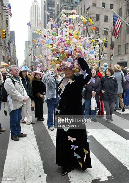 Spectators watch as Vanessa Sterbenz of Manhattan shows off her Easter Bonnet on Fifth Avenue 11 April 2004 in New York The Easter Parade along Fifth...