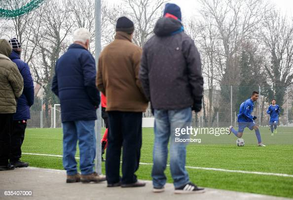 Spectators watch Brazilian players of Slovakian football club FC STK Samorin during a friendly soccer match against Hungarian football club MTE...