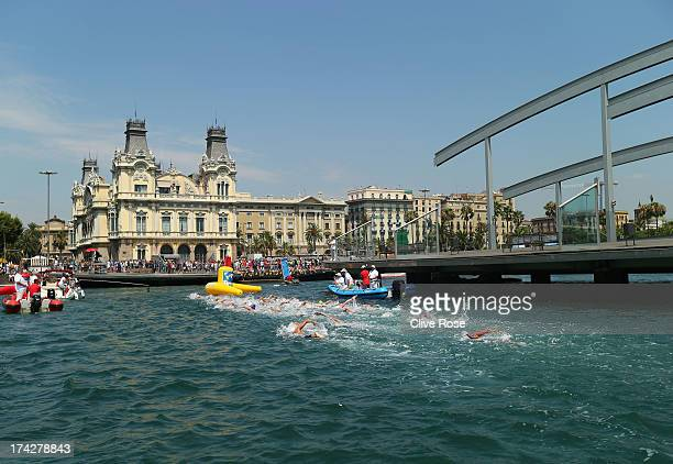 Spectators watch competitors in action during the Open Water Swimming Women's 10k race on day four of the 15th FINA World Championships at Moll de la...