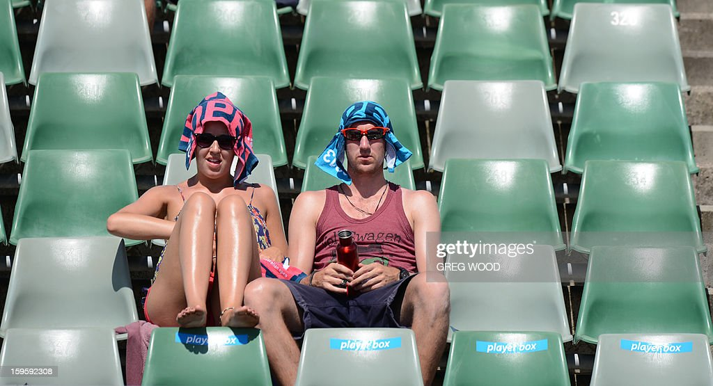 Spectators watch Croatia's Marin Cilic during his men's singles match against Rajeev Ram of the US on the fourth day of the Australian Open tennis tournament in Melbourne on January 17, 2013.