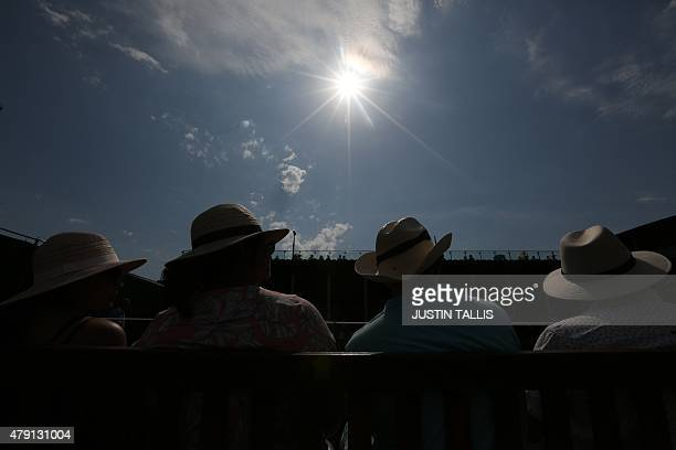 Spectators watch doubles matches on the outer courts on day three of the 2015 Wimbledon Championships at The All England Tennis Club in Wimbledon...