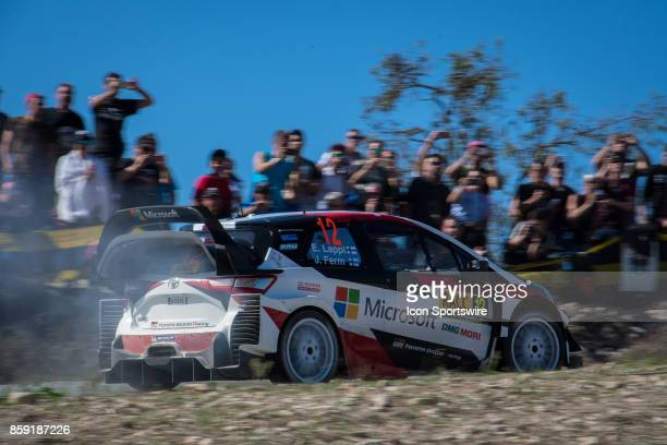 Spectators watch Esapekka Lappi and codriver Janne Ferm of Toyota Gazoo Racing during second run of the Savalla Stage of the Rally de Espana round of...