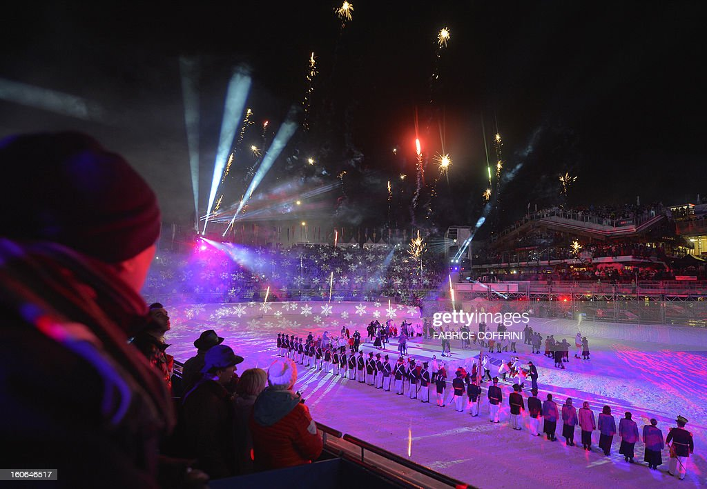 Spectators watch fireworks during the opening ceremony of the FIS World Ski Championships on February 4, 2013 in Schladming. AFP PHOTO / FABRICE COFFRINI