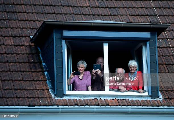 Spectators watch from a window during a CDU campaign rally ahead of state elections in North RhineWestphalia on May 10 2017 in Haltern am See Germany...