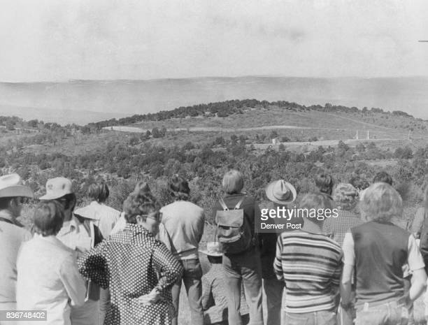 Spectators watch from an observation post 12 miles from the Project Rio Blanco blast site seconds after the detonation The blast centered in right...