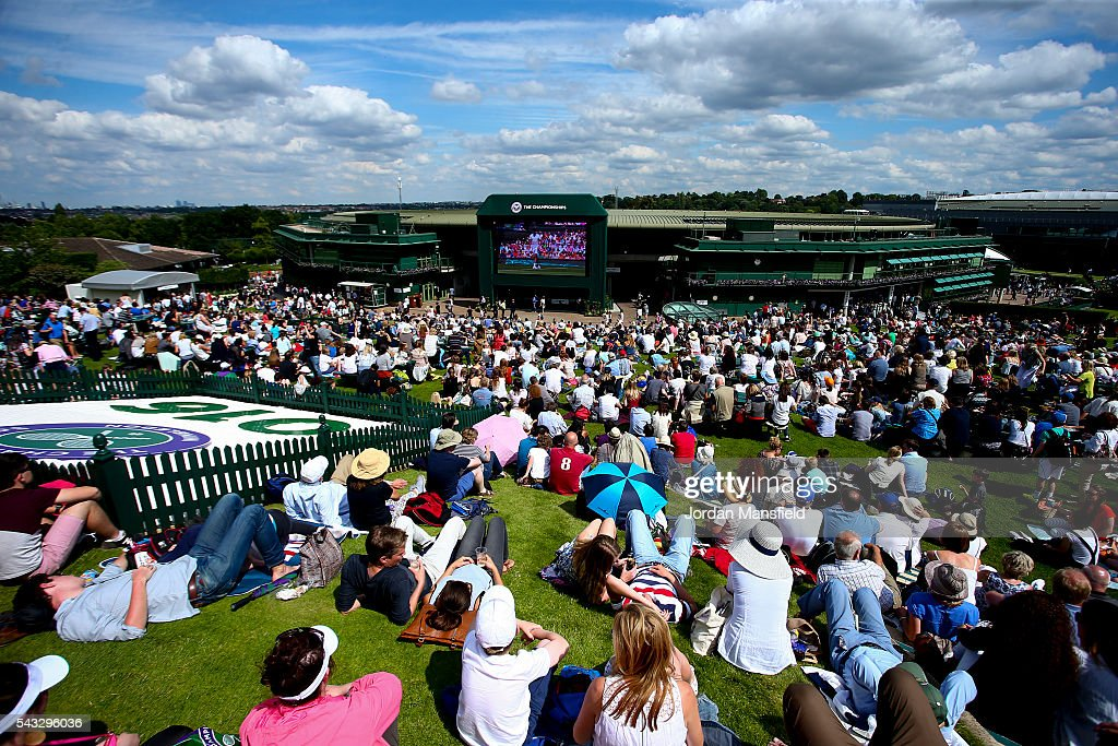 Spectators watch from Murray Mound during day one of the Wimbledon Lawn Tennis Championships at the All England Lawn Tennis and Croquet Club on June 26, 2016 in London, England.