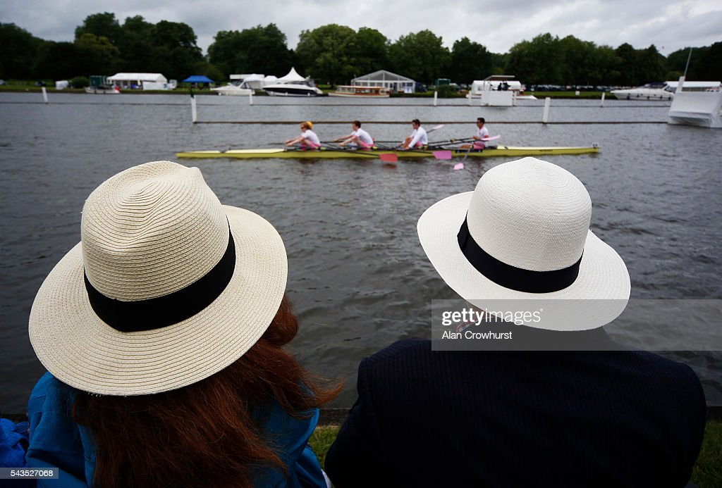 Spectators watch from the river bank as a crew make their way to the start during the Henley Royal Regatta on June 29, 2016 in Henley-on-Thames, England.