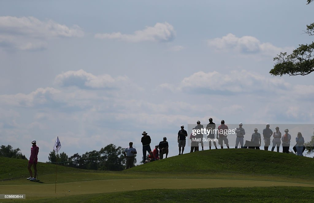 Spectators watch golfers around the green on the 15th hole during the second round of the Yokohama Tire Classic on May 06, 2016 in Prattville, Alabama.
