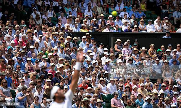 Spectators watch in the crowd as Argentina's Juan Martin Del Potro plays Serbia's Novak Djokovic in the first men's singles semifinal match on day...