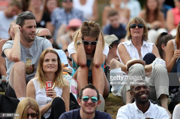 Spectators watch Johanna Konta's semi final match against Venus Williams from Murray Mound on day ten of the Wimbledon Championships at The All...