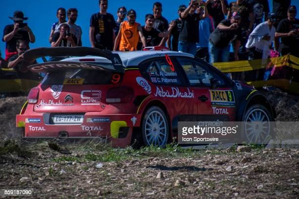 Spectators watch Kahlid Al Qassimi and codriver Chris Patterson of Citroën World Rally Team during second run of the Savalla Stage of the Rally de...