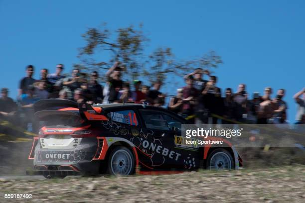 Spectators watch Mads Ostberg and codriver Torstein Eriksen of MSport World Rally Team during second run of the Savalla Stage of the Rally de Espana...