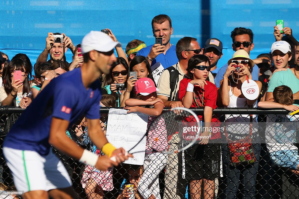 Spectators watch Novak Djokovic of Serbia in a practice session during day ten of the 2013 Australian Open at Melbourne Park on January 23, 2013 in Melbourne, Australia.