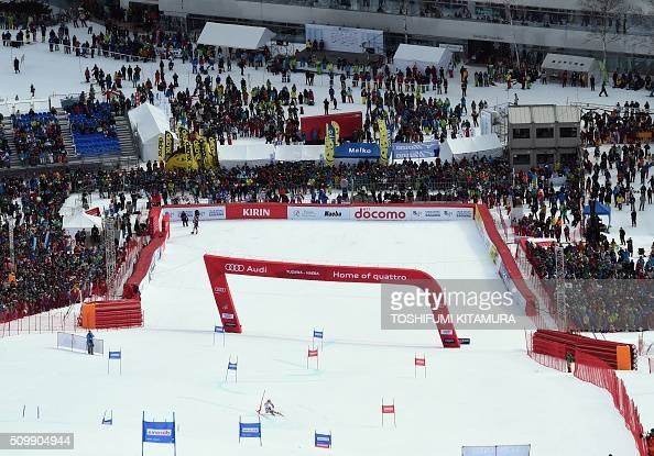 Spectators watch Philipp Schoerghofer of Austria skiing down the course during his first run at the FIS Ski World Cup 2015/2016 6th men's giant...