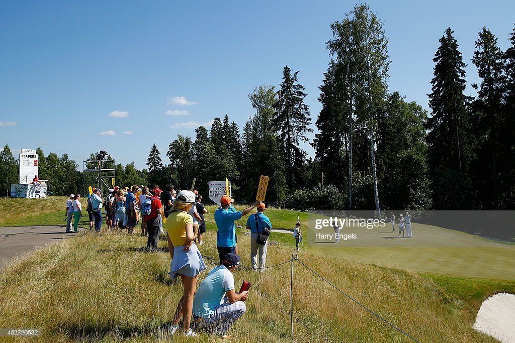 Spectators watch play at the seventeenth green on day three of the M2M Russian Open at Tseleevo Golf & Polo Club on July 26, 2014 in Moscow, Russia.
