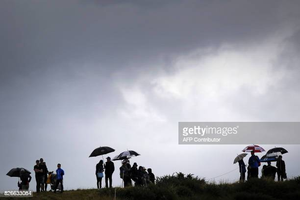 Spectators watch play under stormy skies on day 3 of the 2017 Women's British Open Golf Championship at Kingsbarns Golf Links near St Andrews east...