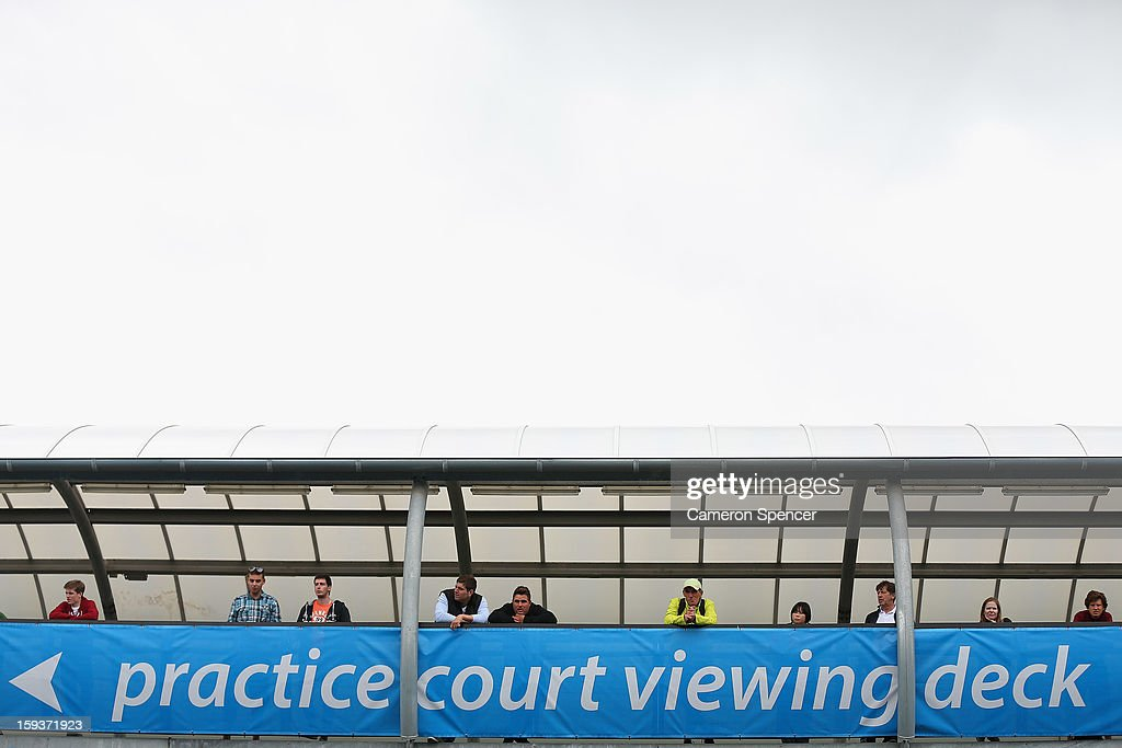 Spectators watch players training ahead of the 2013 Australian Open at Melbourne Park on January 13, 2013 in Melbourne, Australia.