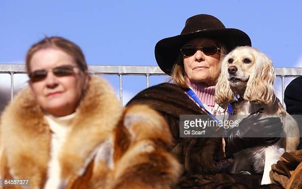 Spectators watch Polo players for the Cartier and Maybach teams compete in the 'Cartier Polo World Cup on Snow' which is held on the frozen Lake of...