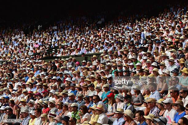 Spectators watch Roger Federer of Switzerland in the Gentlemens Singles Semi Final match against Andy Murray of Great Britain during day eleven of...