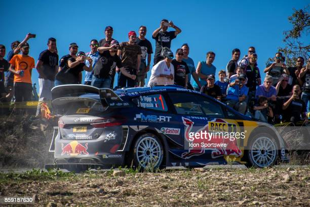 Spectators watch Sébastien Ogier and codriver Julien Ingrassia of MSport during second run of the Savalla Stage of the Rally de Espana round of the...