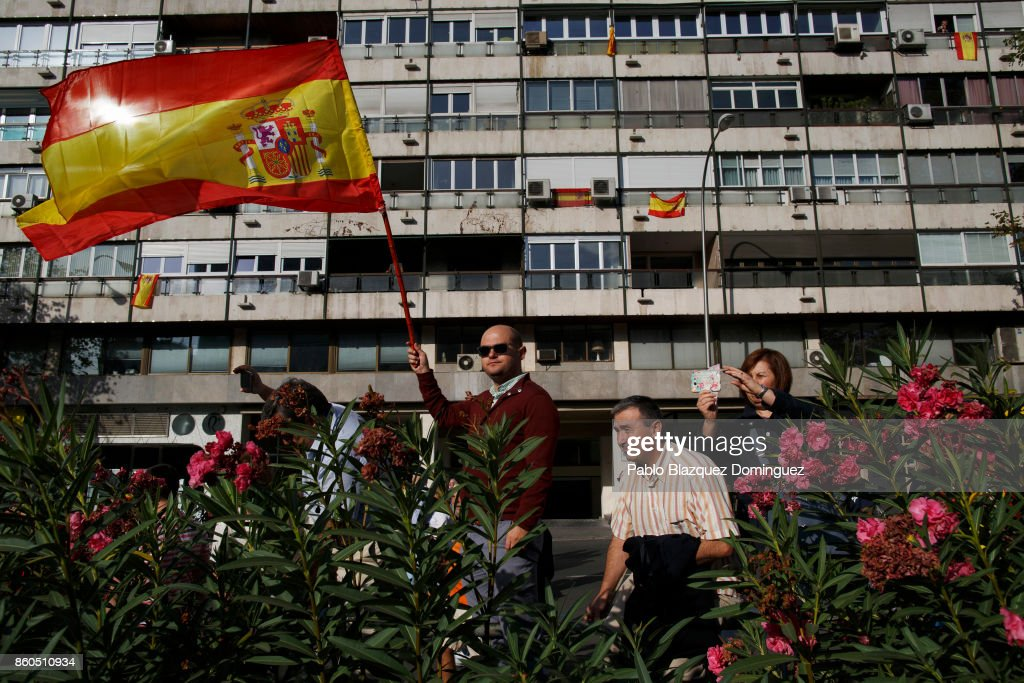 Spectators watch soldiers before the start of Spain's National Day military parade on Castellana Street on October 12, 2017 in Madrid, Spain. Every October 12 Madrid celebrates Spain's National Day, also called Hispanic Day, with a military parade presided by Royal Family and the Spanish Prime Minister. This year the parade takes place as Spain faces a rise in tensions with Catalonia after the referendum vote for independence.