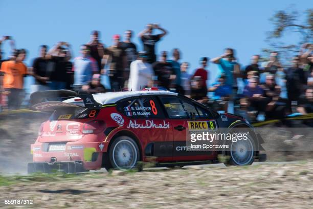 Spectators watch Stéphane Lefebvre and codriver Gabin Moreau of Citroën World Rally Team during second run of the Savalla Stage of the Rally de...