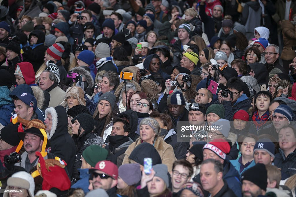 Spectators watch the 88th Annual Thanksgiving Day Parade on November 27, 2014 in New York City.
