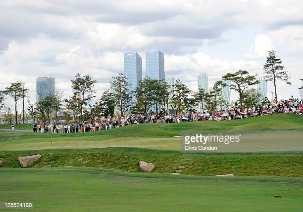 Spectators watch the action at the 14th hole during the final round of the Songdo IBD Championship presented by Korean Air at Jack Nicklaus Golf...