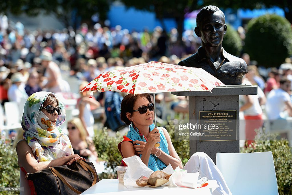 Spectators watch the action in Garden Square during day seven of the 2013 Australian Open at Melbourne Park on January 20, 2013 in Melbourne, Australia.