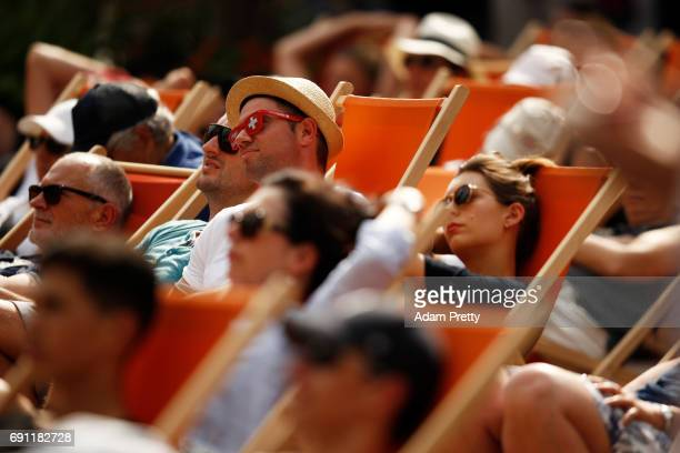 Spectators watch the action on a giant screen on day five of the 2017 French Open at Roland Garros on June 1 2017 in Paris France