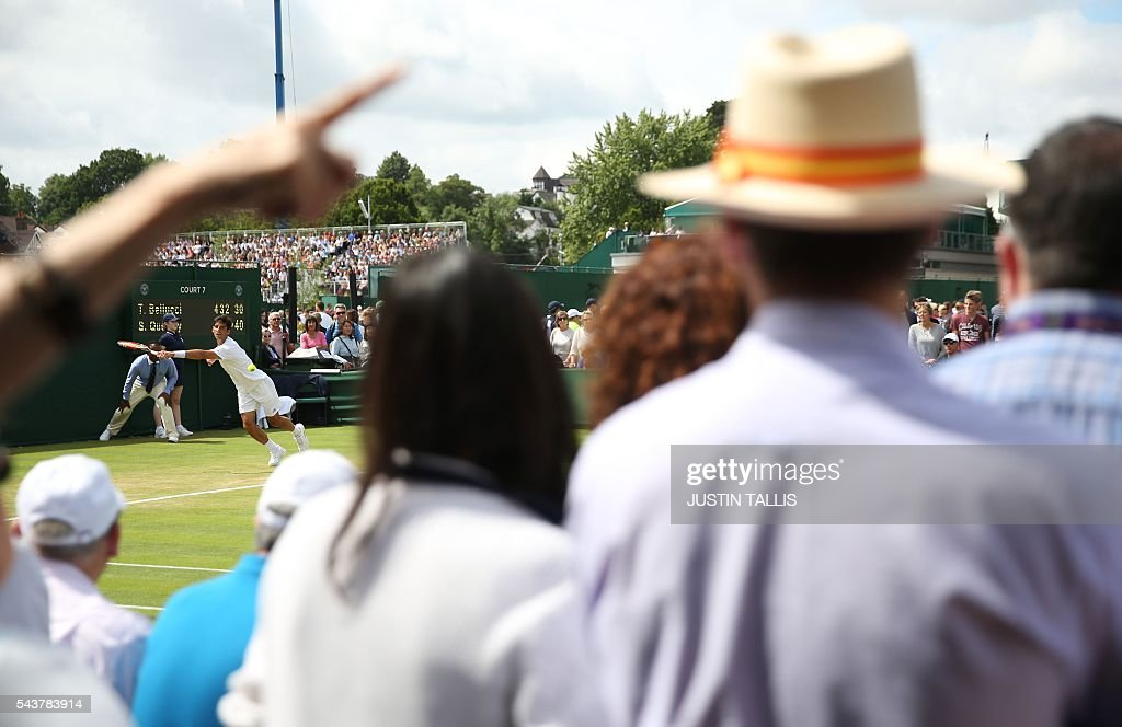 Spectators watch the action on the fourth day of the 2016 Wimbledon Championships at The All England Lawn Tennis Club in Wimbledon, southwest London, on June 30, 2016. / AFP / JUSTIN