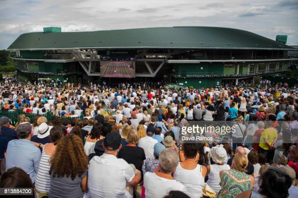 Spectators watch the action on the screen from 'Murray Mound' during the Ladies Singles semi final match between Johanna Konta of Great Britain and...