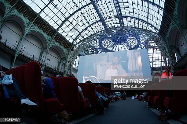 Spectators watch The Big Lebowski at the Grand Palais in Paris on June 11 during the Cinema Paradiso the transformation of the Grand Palais into a...