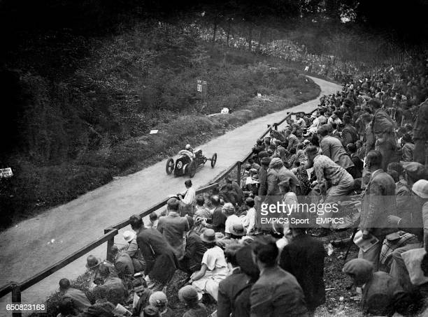 Spectators watch the cars racing at Shelsley Walsh Hill