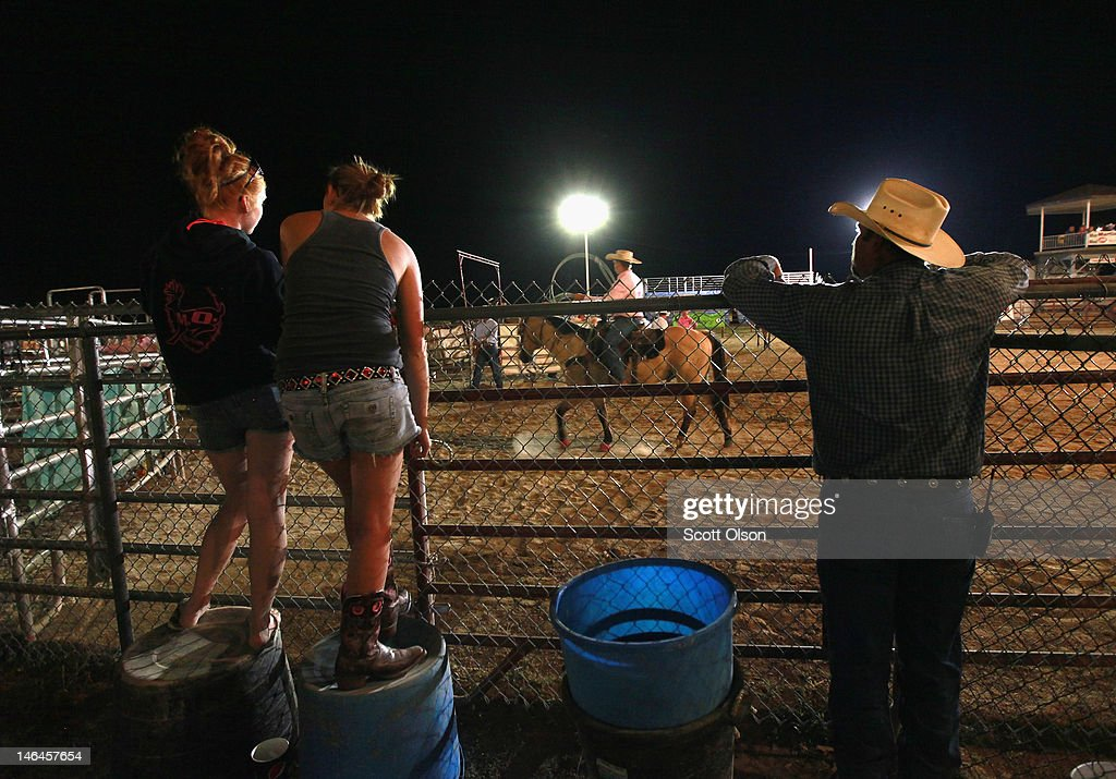 Spectators watch the events at the Illinois High School Rodeo Association State Finals on June 16, 2012 in Altamont, Illinois. Winners in the competition will go on to compete in the high school national championships July 15-21 in Rock Springs, Wyoming.