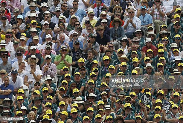 Spectators watch the first day of the second Ashes cricket test match between England and Australia at Lord's cricket ground in London on July 16...