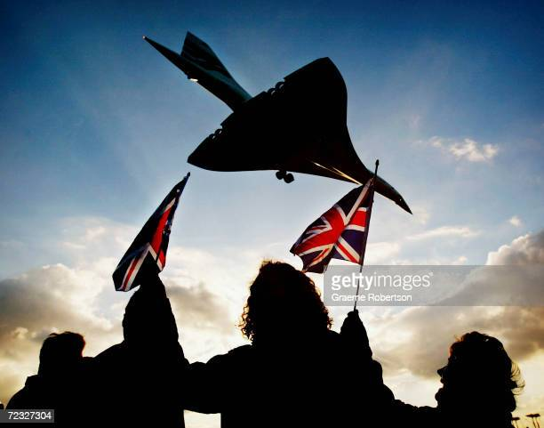 Spectators watch the last ever British Airways commercial Concorde flight touch down at Heathrow airport October 24 2003 in London The world's only...