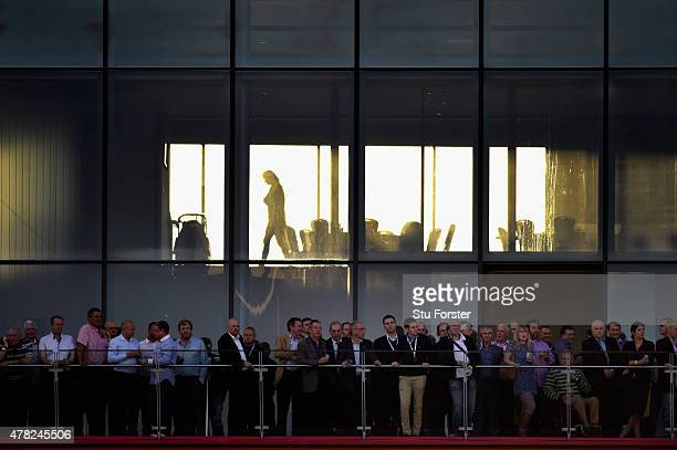 Spectators watch the match from the point during the NatWest International Twenty20 match between England and New Zealand at Old Trafford on June 23...