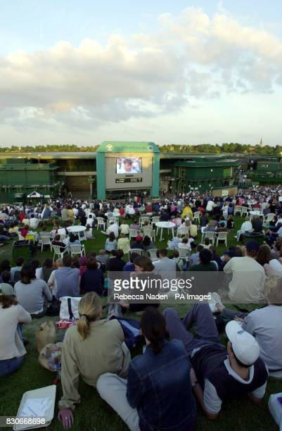 Spectators watch the nail biting conclusion of the match between Great Britain's Barry Cowan and Pete Sampras of USA during the Second Round match of...