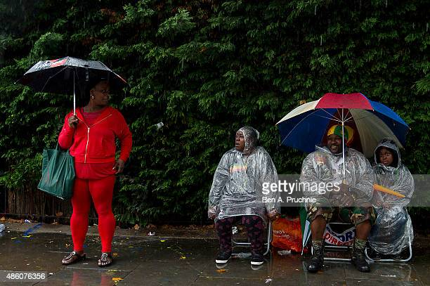 Spectators watch the parade during Notting Hill Carnival on August 31 2015 in London England The Carnival the largest in Europe is a street party...