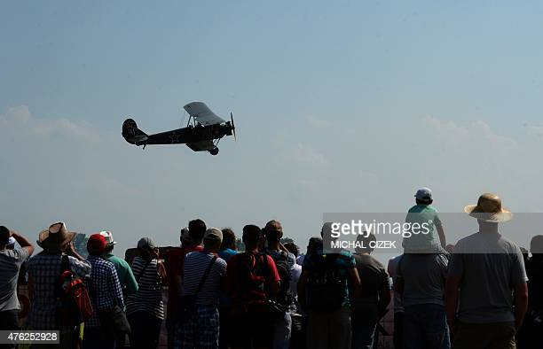 Spectators watch the performance of a Polikarpov Po 2 airplane during the 25th ''Aviation fair'' airshow at Pardubice airpot in Pardubice city on...