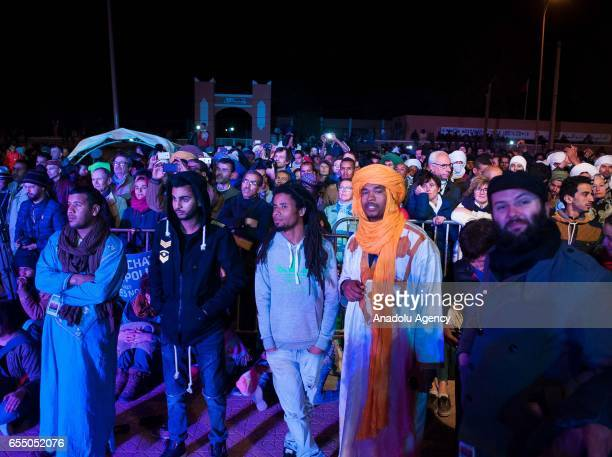 Spectators watch the performance of Nigerian Muhtar Gomara music band during the 14th International Nomads Festival in M'Hamid El Ghizlane town of...